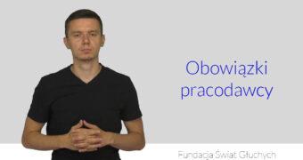 na zdjęciu Michał Konwerski, po prawej napis